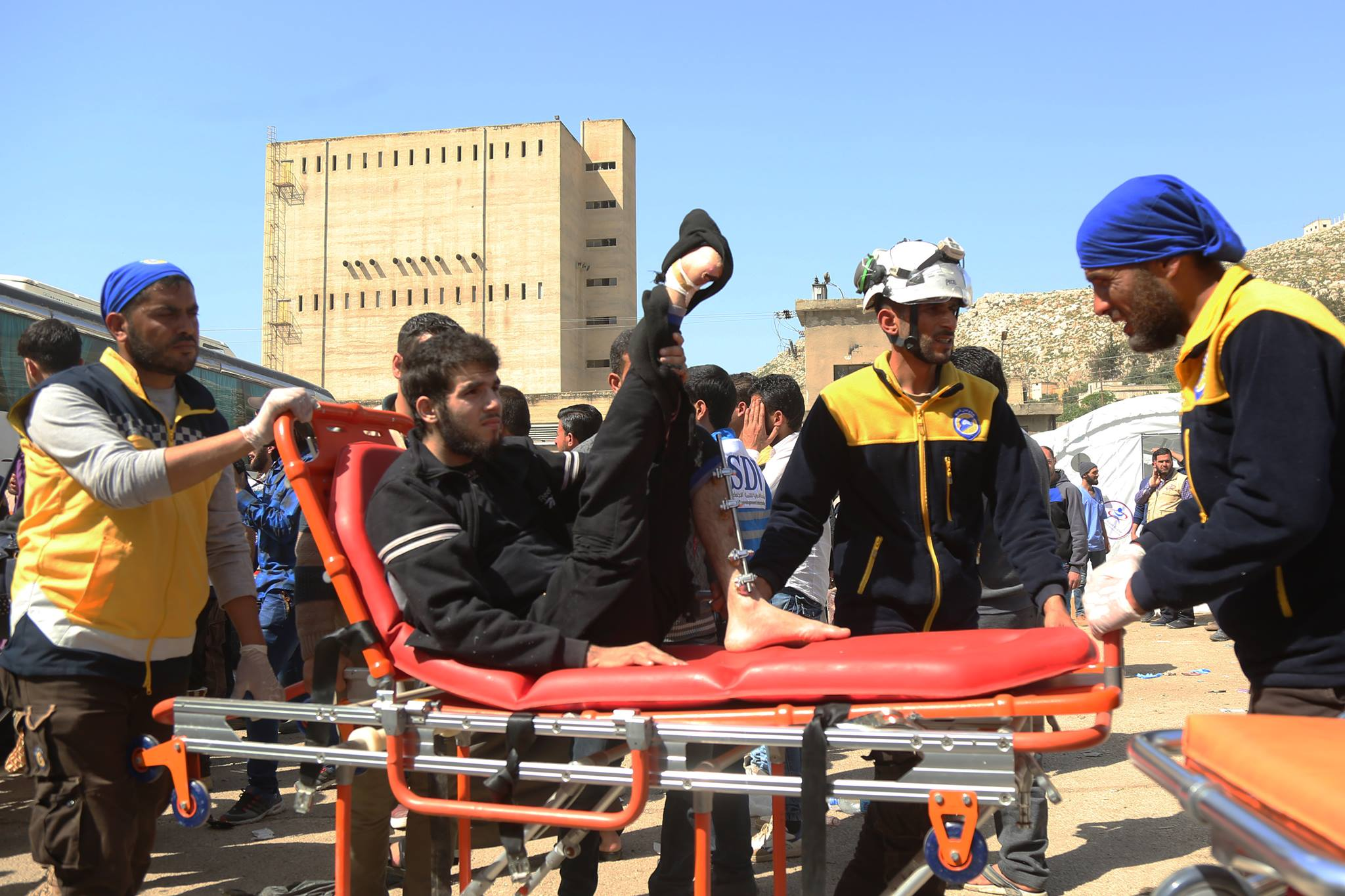 An injured deportee received by the White Helmets
