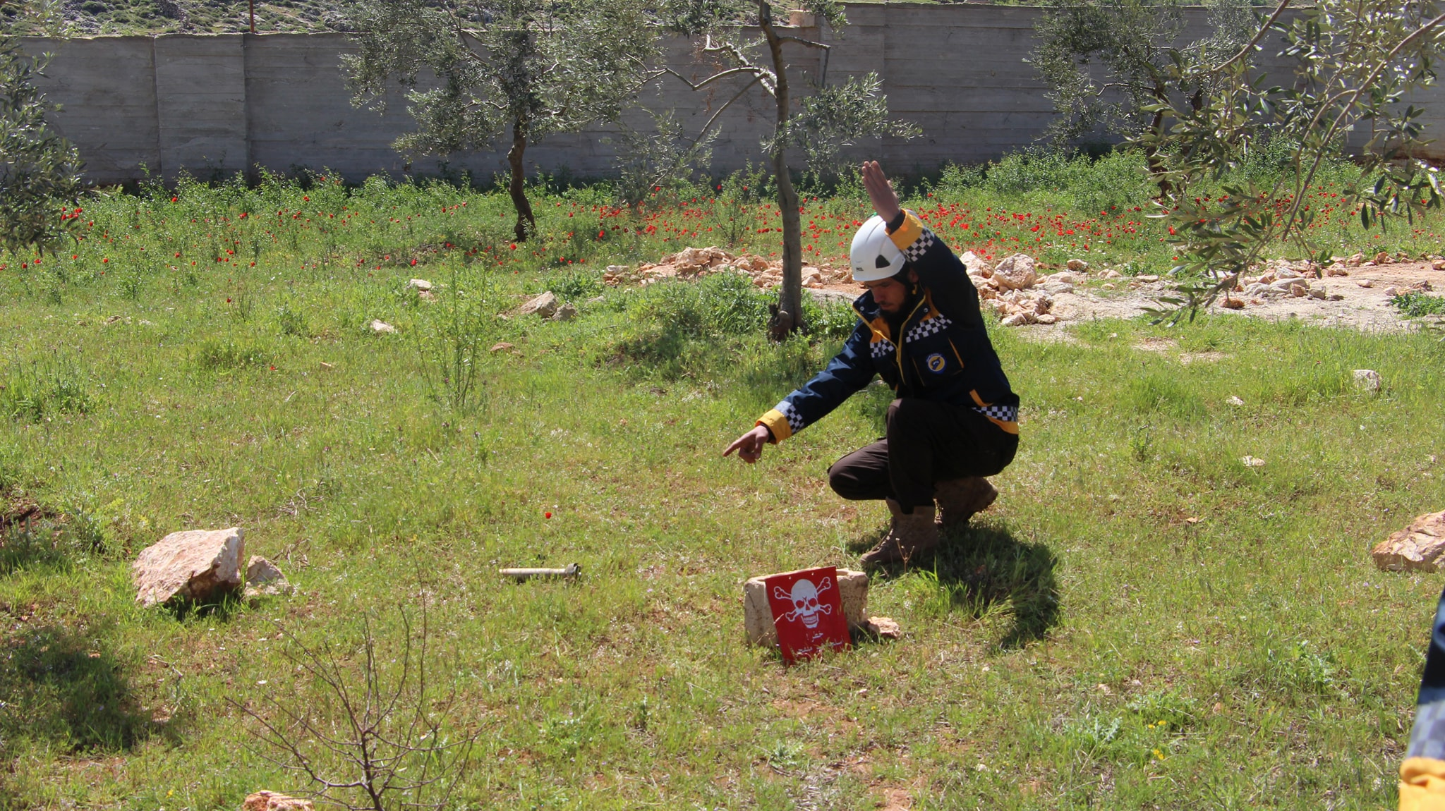 A White Helmentt is locating an unexploded munition