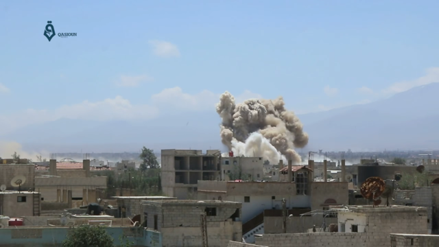 Two bombs are dropped by the Syrian Arab Air Force on the city of Darayya, southwest of Damascus, during its siege.